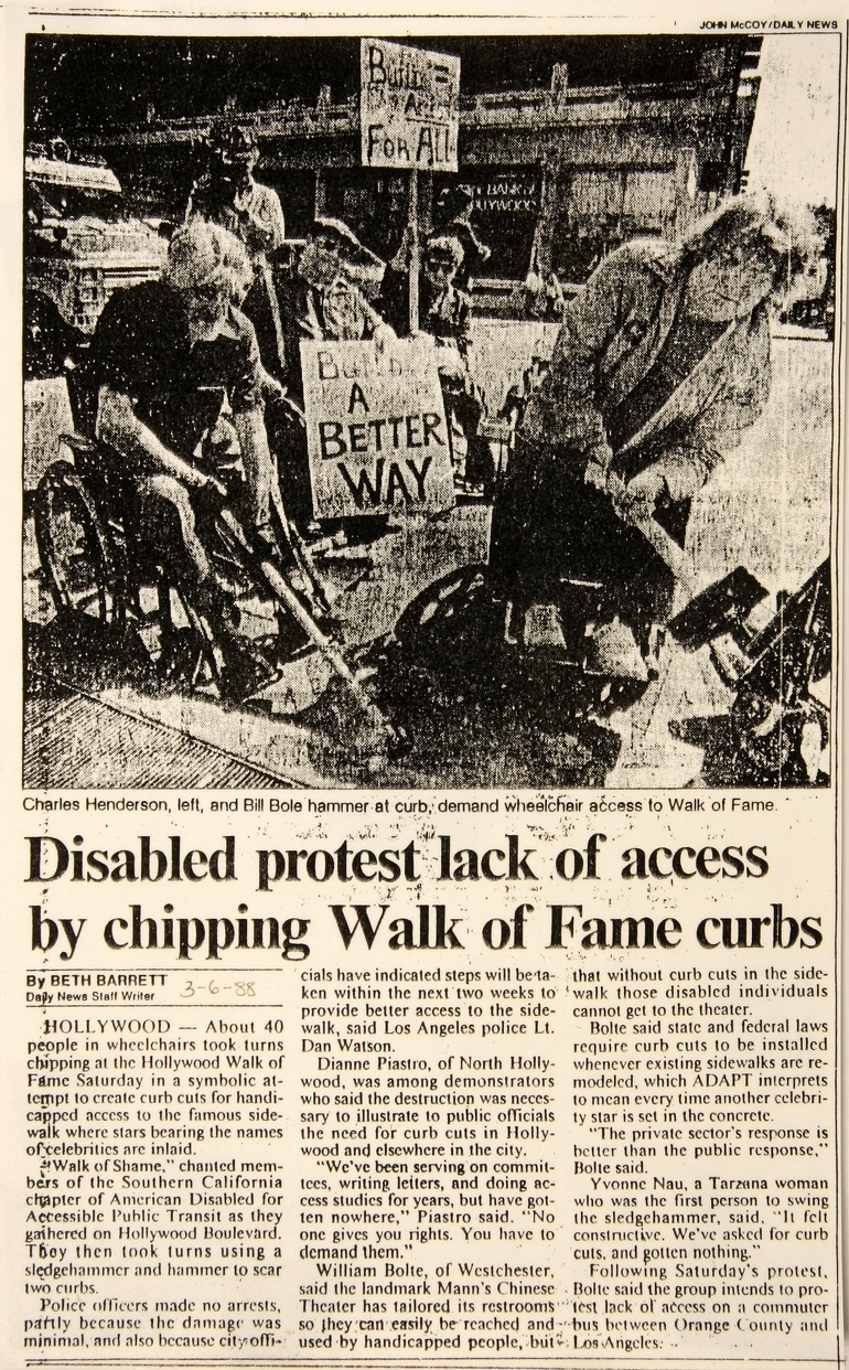 Newspaper clipping from 1988 picturing disability right activists in Los Angeles smashing curbs with sledgehammers.
